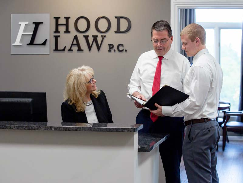 Hood Law PC - Tom and Dan Hood by front desk